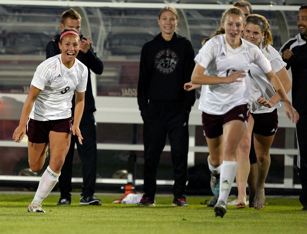 . Cheyenne Mountain Sara Walters (8) runs out on to the field to  celebrate their win over Broomfield 2-0 to capture the  4A girls State Soccer Championship May 21, 2014 at Dick\'s Sporting Goods Park. (Photo by John Leyba/The Denver Post)