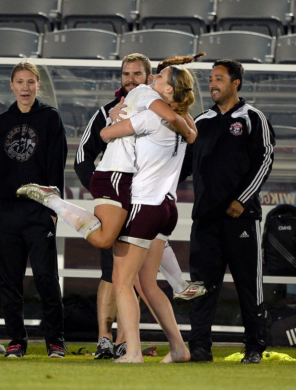 . Cheyenne Mountain Sara Walters (8) and Hannah Gerdin (14) celebrate their win over Broomfield 2-0 to capture the  4A girls State Soccer Championship May 21, 2014 at Dick\'s Sporting Goods Park. (Photo by John Leyba/The Denver Post)