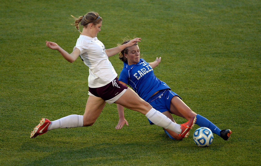 . Broomfield Zoe Zinis (9) kicks the ball away from Cheyenne Mountain Hannah Gerdin (14) during the first half in the 4A girls State Soccer Championship May 21, 2014 at Dick\'s Sporting Goods Park. Cheyenne Defeated Broomfield 2-0. (Photo by John Leyba/The Denver Post)