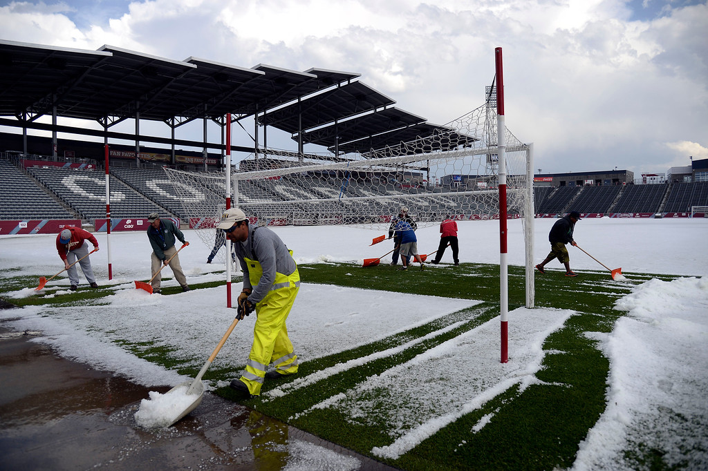 . Grounds crew push the hail off the field at Dick\'s Sporting Goods Park. Hail pounded Commerce City blanketing the field at Dick\'s Sporting Goods Park May 21, 2014, where they were about to hold the class 4A soccer finals. (Photo by John Leyba/The Denver Post)