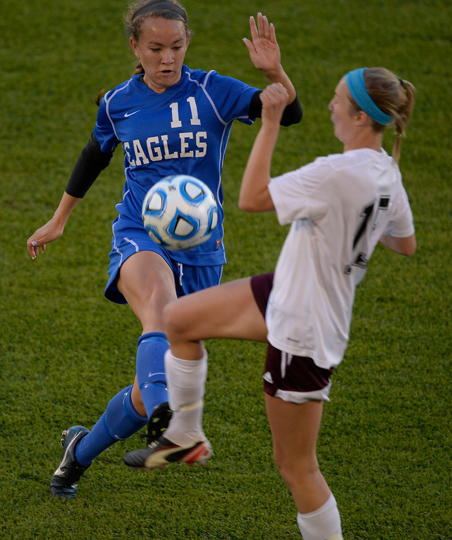 . Broomfield Kayla Snyder (11) and Cheyenne Mountain Ellen Smith (15) both go after the ball during the first half of the 4A girls State Soccer Championship May 21, 2014 at Dick\'s Sporting Goods Park. Cheyenne Mountain defeated Broomfield 2-0 for the title. (Photo by John Leyba/The Denver Post)