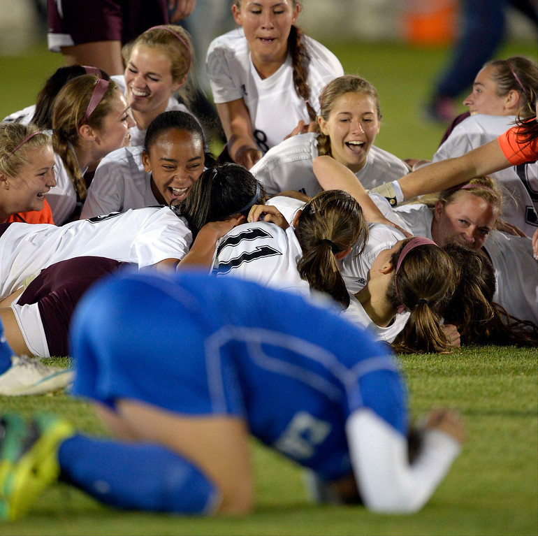 . Cheyenne Mountain celebrate their win as Broomfield Lerry Marquardt (21) kneels dejected after their loss 2-0 in the  4A girls State Soccer Championship May 21, 2014 at Dick\'s Sporting Goods Park. (Photo by John Leyba/The Denver Post)