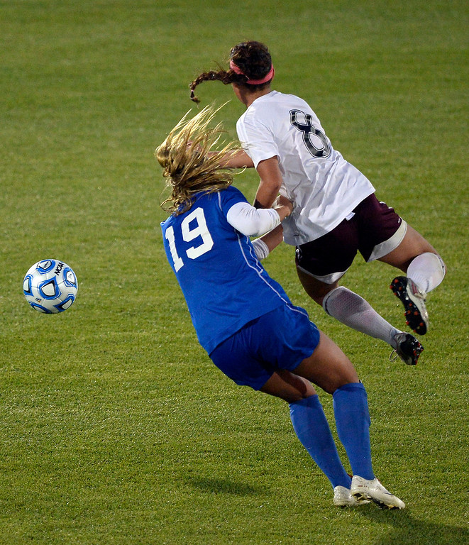 . Broomfield Hailey Mazzola (19) and Cheyenne Mountain Sara Walters (8) collide as they go for the ball during the second half of the 4A girls State Soccer Championship May 21, 2014 at Dick\'s Sporting Goods Park. Cheyenne Mountain defeated Broomfield 2-0. (Photo by John Leyba/The Denver Post)
