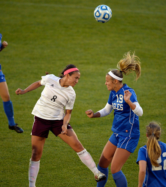 . Broomfield Hailey Mazzola (19) and Cheyenne Mountain Sara Walters (8) both attempt to head the ball during the first half in  the 4A girls State Soccer Championship May 21, 2014 at Dick\'s Sporting Goods Park. Cheyenne Mountain defeated Broomfield 2-0. (Photo by John Leyba/The Denver Post)