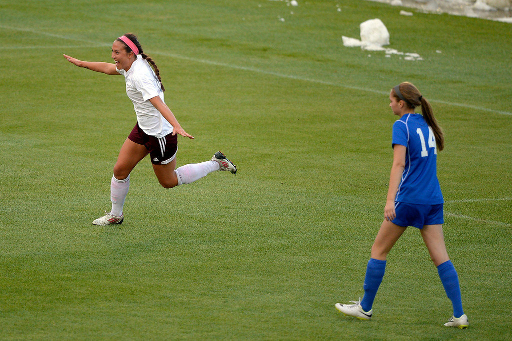 . Cheyenne Mountain Sara Walters (8) celebrates her goal in the first half as Broomfield Sara Casasanta walks dejected during the 4A girls State Soccer Championship May 21, 2014 at Dick\'s Sporting Goods Park. Cheyenne Mountain defeated Broomfield 2-0 for the title. (Photo by John Leyba/The Denver Post)