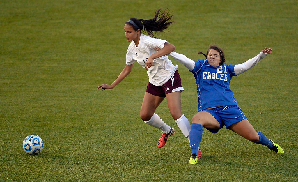 . Cheyenne Mountain Thalia Kusulas (18) kicks the ball away from  Broomfield Lerry Marquardt (21) during the first half of  the 4A girls State Soccer Championship May 21, 2014 at Dick\'s Sporting Goods Park. Cheyenne Mountain defeated Broomfield 2-0 for the title. (Photo by John Leyba/The Denver Post)