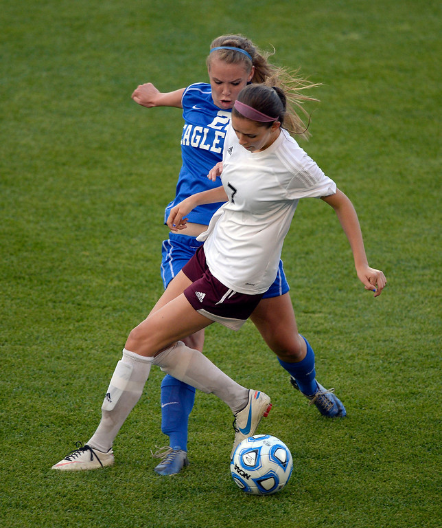 . Broomfield Katie Forsee (22) and Cheyenne Mountain Kyra Darr (7) battle for the ball during the first half of the 4A girls State Soccer Championship May 21, 2014 at Dick\'s Sporting Goods Park. Cheyenne Mountain defeated Broomfield 2-0. (Photo by John Leyba/The Denver Post)