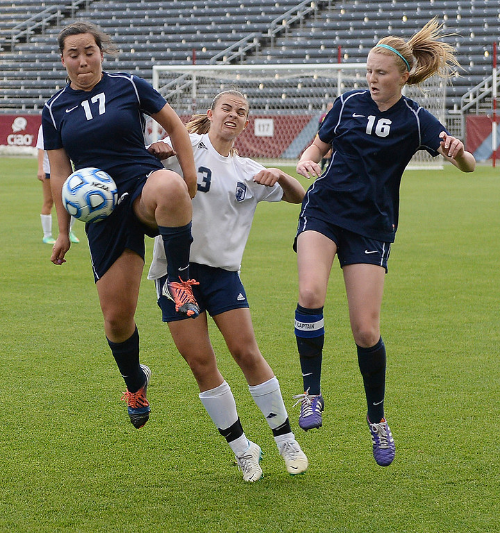 . Columbine senior midfielder Baylie Schmitz (3) fought off Ralston Valley defenders Brenna Martinez (17) and Kasee Horton (16) in the first half. The Columbine High School girl\'s soccer team took on Ralston Valley in the 5A championship game Thursday night, May 22, 2014.  (Photo by Karl Gehring/The Denver Post)