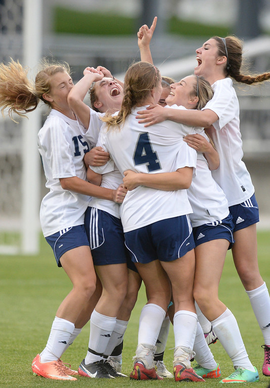 . The Rebels celebrated the team\'s second goal of the night. The laser shot from forward Amanda Porter would be the game winning goal. The Columbine High School girl\'s soccer team defeated Ralston Valley 3-1 in the 5A championship game Thursday night, May 22, 2014.  (Photo by Karl Gehring/The Denver Post)
