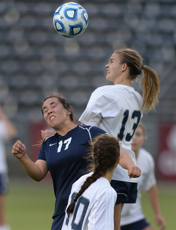 . Ralston Valley midfielder Brenna Martinez (17) and Columbine forward Amanda Porter (13) competed for a ball in the second half. The Columbine High School girl\'s soccer team defeated Ralston Valley 3-1 in the 5A championship game Thursday night, May 22, 2014.  (Photo by Karl Gehring/The Denver Post)