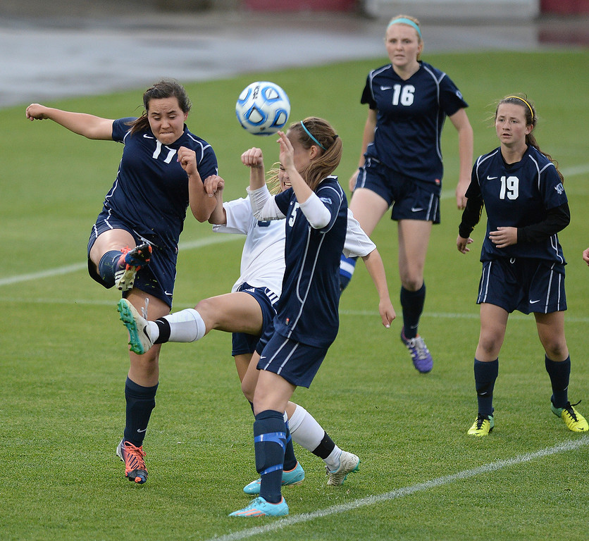 . Columbine freshman forward Amanda Porter (13) took a whack at a corner kick attempt in the second half. The Columbine High School girl\'s soccer team defeated Ralston Valley 3-1 in the 5A championship game Thursday night, May 22, 2014.  (Photo by Karl Gehring/The Denver Post)