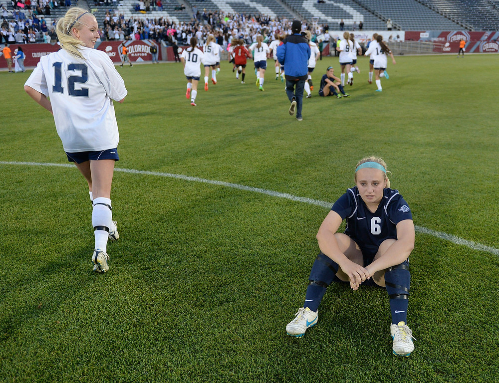 . Ralston Valley senior defender Taylor Lawrence (6) was forced to watch the Rebels celebrate. The Columbine High School girl\'s soccer team defeated Ralston Valley 3-1 in the 5A championship game Thursday night, May 22, 2014.  (Photo by Karl Gehring/The Denver Post)