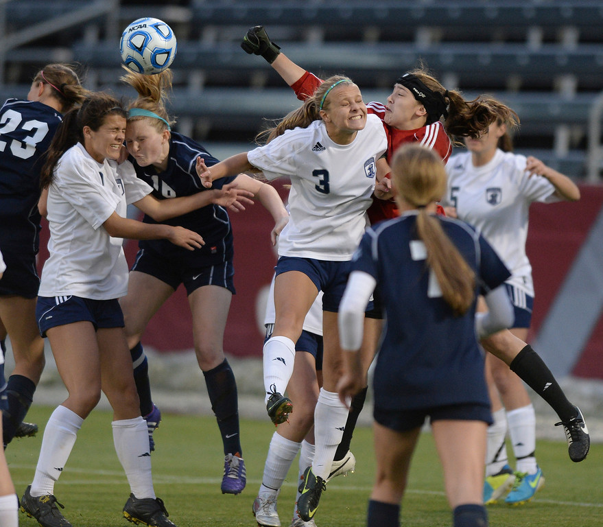 . Colombine goalie Sarah Luebking punched the ball away on a Ralston Valley corner kick in the second half. The Columbine High School girl\'s soccer team defeated Ralston Valley 3-1 in the 5A championship game Thursday night, May 22, 2014.  (Photo by Karl Gehring/The Denver Post)