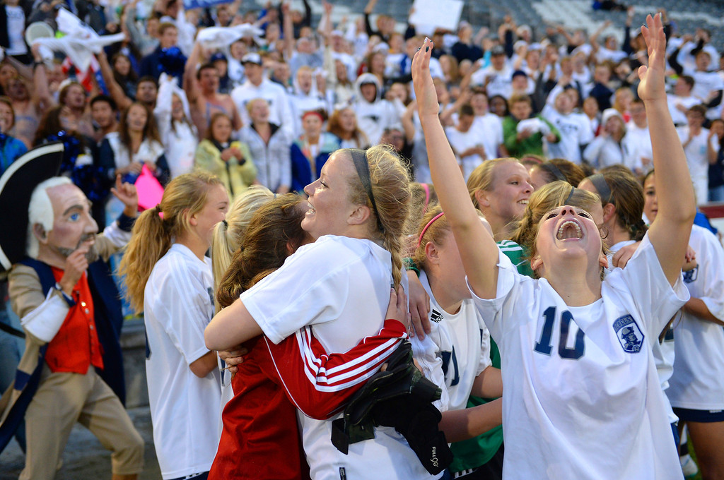 . Senior Andonia Apergis (10) and the Rebels celebrated the win. The Columbine High School girl\'s soccer team defeated Ralston Valley 3-1 in the 5A championship game Thursday night, May 22, 2014.  (Photo by Karl Gehring/The Denver Post)