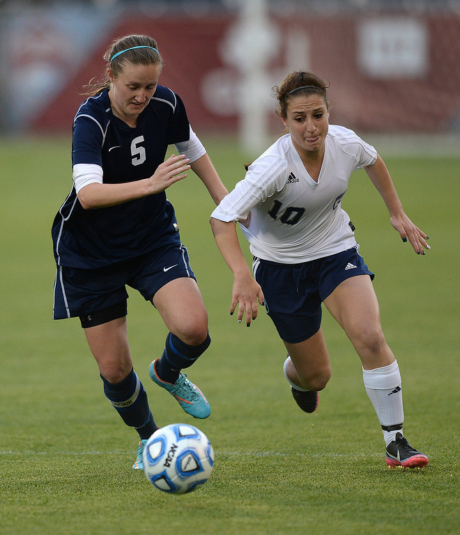 . Columbine senior forward Andonia Apergis (10) tried to get past Mustangs\' defender Maddie Allensworth (5) in the second half. The Columbine High School girl\'s soccer team defeated Ralston Valley 3-1 in the 5A championship game Thursday night, May 22, 2014.  (Photo by Karl Gehring/The Denver Post)