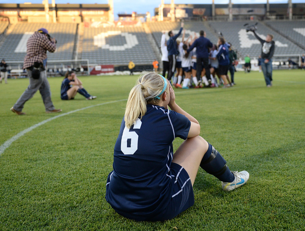 . Ralston Valley senior defender Taylor Lawrence (6) found it hard to watch the Rebels celebrate after the final whistle. The Columbine High School girl\'s soccer team defeated Ralston Valley 3-1 in the 5A championship game Thursday night, May 22, 2014.  (Photo by Karl Gehring/The Denver Post)