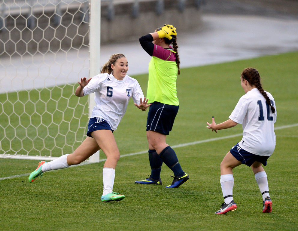 . Rebels forward Tatum Barton (6) and Andonia Apergis (10) celebrated after a ball got through the legs of Ralston Valley goalie Renee Roemer on a lofting free kick by Columbine midfielder Kelcey Cavarra in the second half. The Columbine High School girl\'s soccer team defeated Ralston Valley 3-1 in the 5A championship game Thursday night, May 22, 2014.  (Photo by Karl Gehring/The Denver Post)
