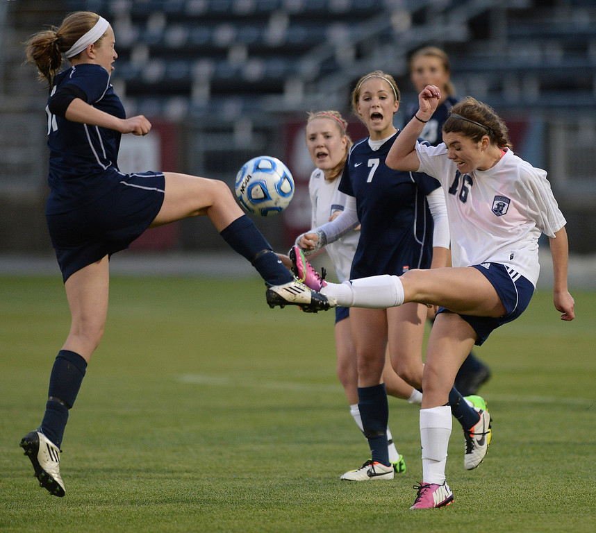 . Columbine sophomore defender Chloe Chapman (16) cleared the ball past Ralston Valley senior forward Janelle Feldmann (11) late in the second half. The Columbine High School girl\'s soccer team defeated Ralston Valley 3-1 in the 5A championship game Thursday night, May 22, 2014.  (Photo by Karl Gehring/The Denver Post)