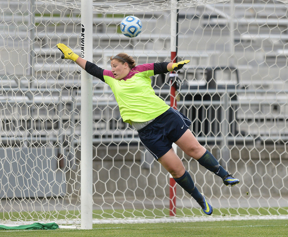 . Columbine freshman forward Amanda Porter put a ball past Ralston Valley goalie Renee Roemer in the second half. This would hold up as the game winning goal. The Columbine High School girl\'s soccer team defeated Ralston Valley 3-1 in the 5A championship game Thursday night, May 22, 2014.  (Photo by Karl Gehring/The Denver Post)