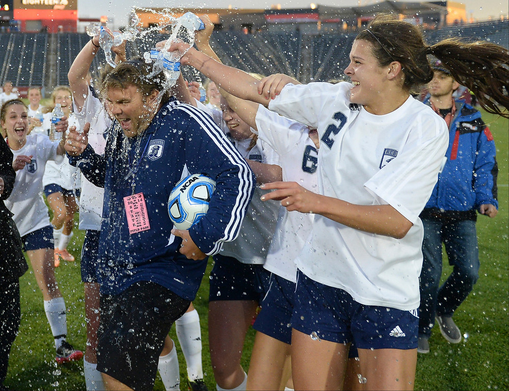 . Rebels coach Brian Todd was doused with water after the win. The Columbine High School girl\'s soccer team defeated Ralston Valley 3-1 in the 5A championship game Thursday night, May 22, 2014.  (Photo by Karl Gehring/The Denver Post)