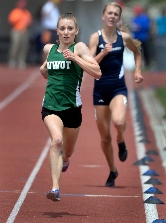 . Record-holder Elise Cranny from Niwot High School crosses the finish line winning the Girls 4A 1600 Meter Run. The Colorado State High School Track and Field meet takes place at Jeffco Stadium in Lakewood on Saturday, May 17, 2014. (Kathryn Scott Osler, The Denver Post)