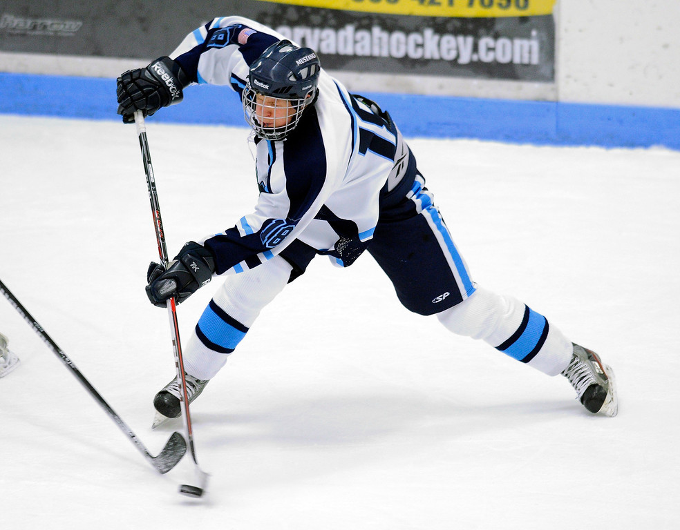 . Ralston Valley junior defenseman Martin Bakula (18) wound up for a shot in the first period.  The defending state champion hockey team from Ralston Valley High School took on Standley Lake Tuesday night, December 17, 2013. Photo By Karl Gehring/The Denver Post
