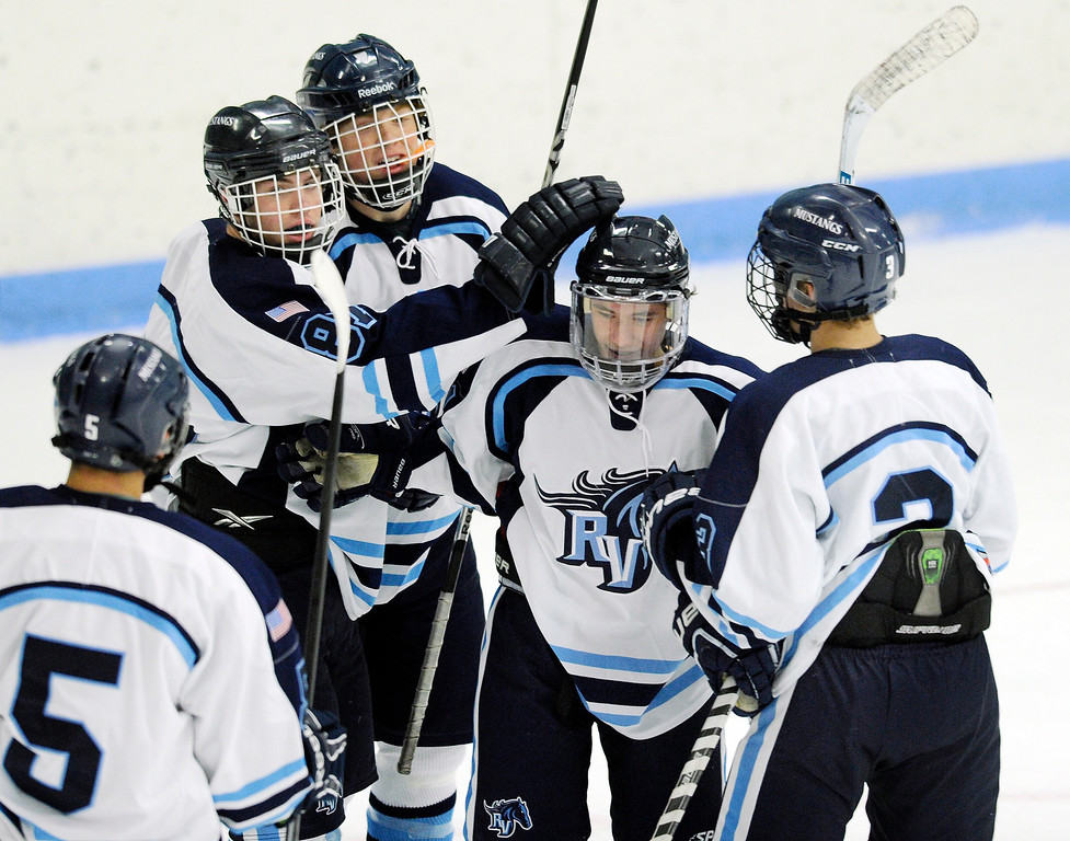 . Mustangs\' senior forward Austin Resseguie had the first goal of the game. The defending state champion hockey team from Ralston Valley High School took on Standley Lake Tuesday night, December 17, 2013. Photo By Karl Gehring/The Denver Post