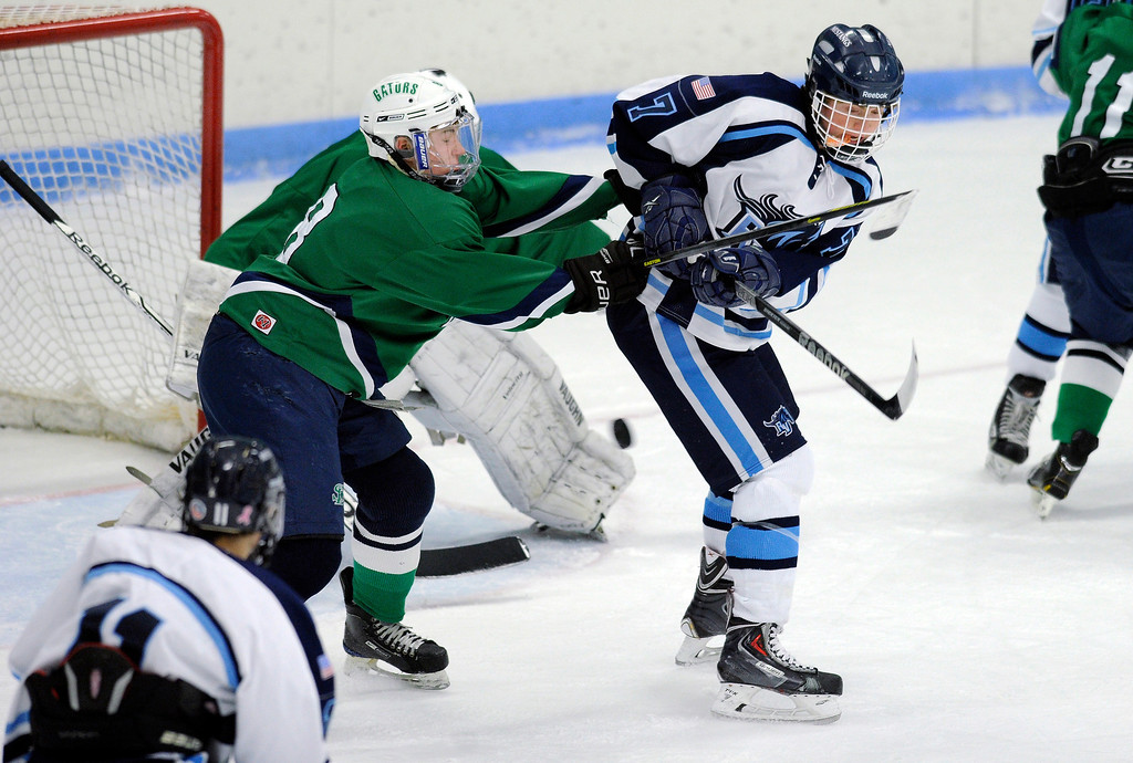 . Ralston Valley senior forward Greg Dyba (7) tried to redirect the puck with his stick in front of Gators\' defender Tanner Pascale (8) in the first period. The defending state champion hockey team from Ralston Valley High School took on Standley Lake Tuesday night, December 17, 2013. Photo By Karl Gehring/The Denver Post