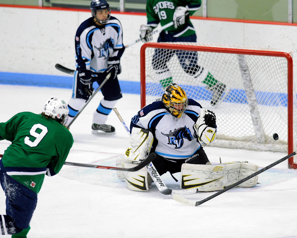 . Standley Lake defenseman Nicholas Schmidt (9) blasted a shot past Mustangs\' goalie Zack LaRocque (31) to tie the game in the first period. The defending state champion hockey team from  Ralston Valley High School took on Standley LakeTuesday night, December 17, 2013. Photo By Karl Gehring/The Denver Post