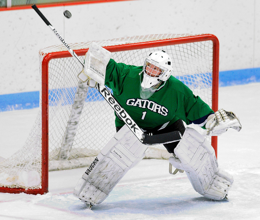 . Standley Lake goalie Ryan Young made a stick save in the first period. The defending state champion hockey team from Ralston Valley High School took on Standley Lake Tuesday night, December 17, 2013. Photo By Karl Gehring/The Denver Post