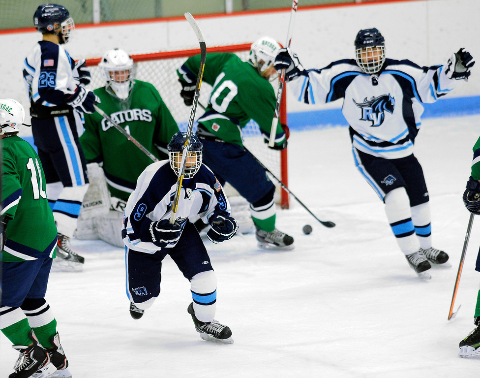 . The Mustangs celebrated their final goal in the third period. The defending state champion 5A hockey team from Ralston Valley High School skated past Standley Lake 6-1 Tuesday night, December 17, 2013. Photo By Karl Gehring/The Denver Post