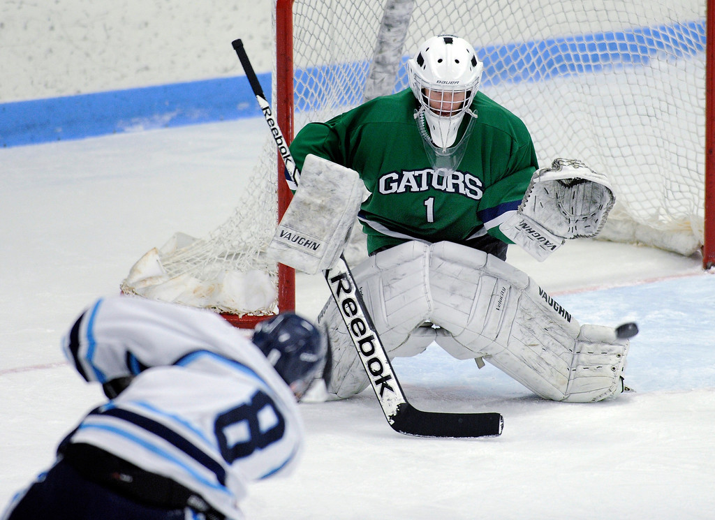 . Ralston Valley senior forward Chris Rockers (8) fired on net in the first period.  The defending state champion hockey team from Ralston Valley High School took on Standley Lake Tuesday night, December 17, 2013. Photo By Karl Gehring/The Denver Post
