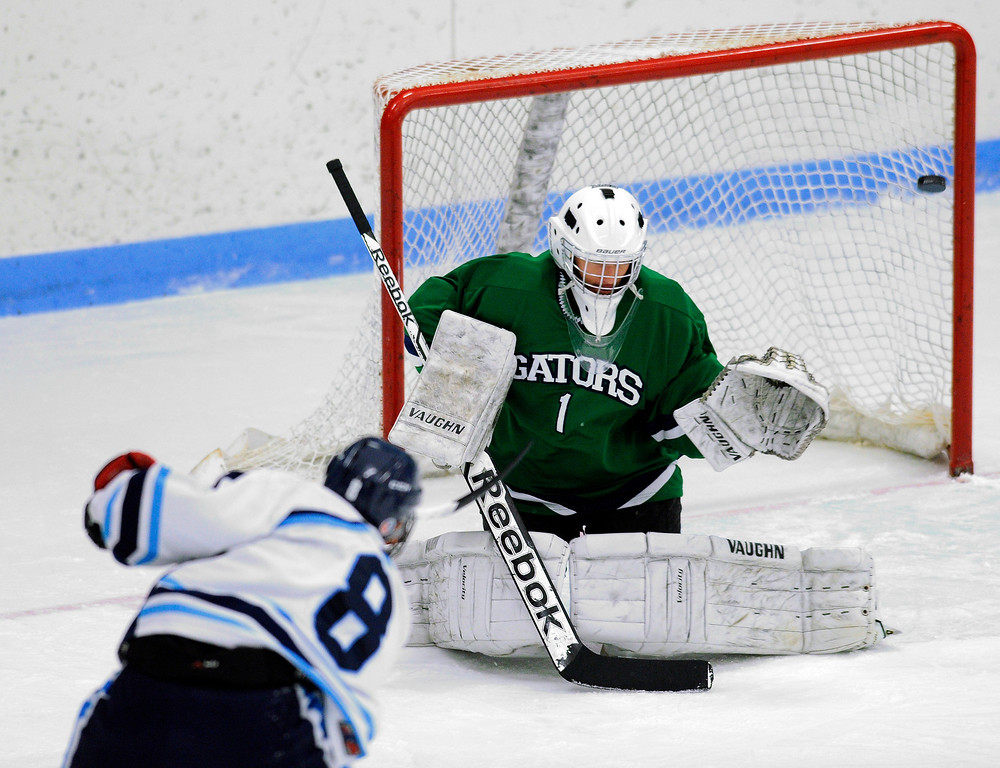 . Mustangs\' senior forward Chris Rockers (8) fired a shot that sailed past Gators\' goaltender Ryan Young and hit the pipe in the first period. The defending state champion hockey team from  Ralston Valley High School took on Standley LakeTuesday night, December 17, 2013. Photo By Karl Gehring/The Denver Post