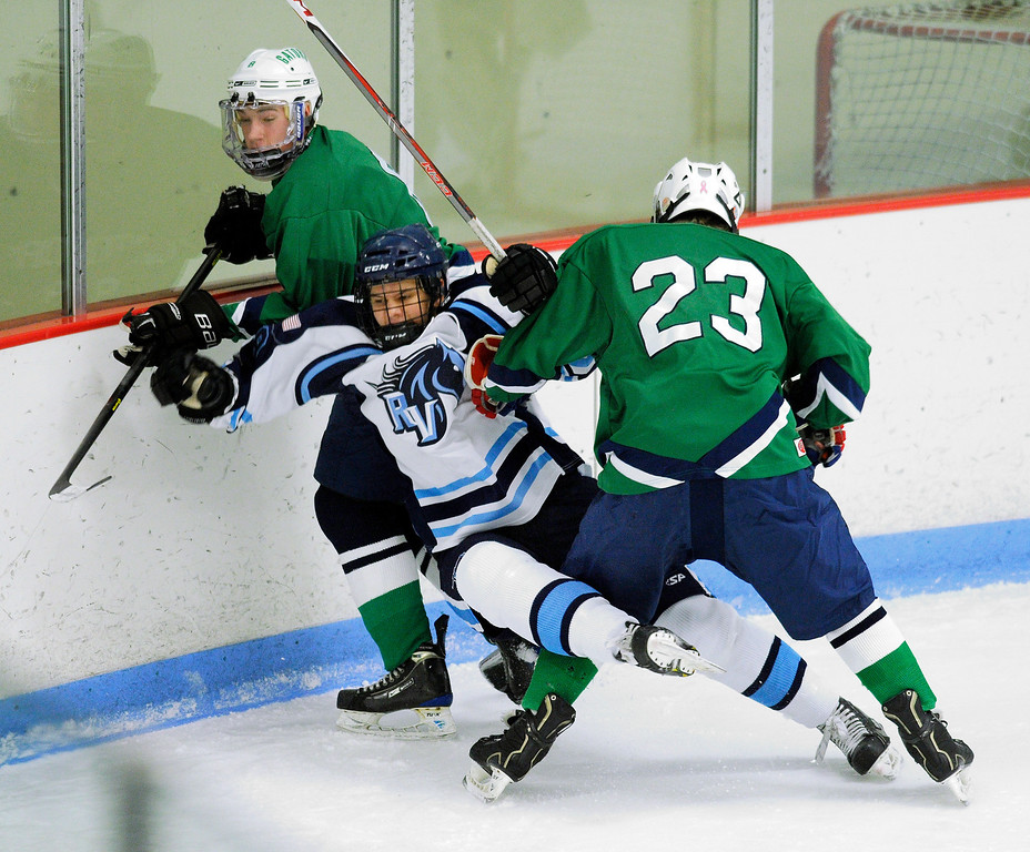 . Standley Lake forward Ryan McCarthy (23) knocked down Ralston Valley senior Chris Rockers (8) in the first period. The defending state champion hockey team from  Ralston Valley High School took on Standley LakeTuesday night, December 17, 2013. Photo By Karl Gehring/The Denver Post
