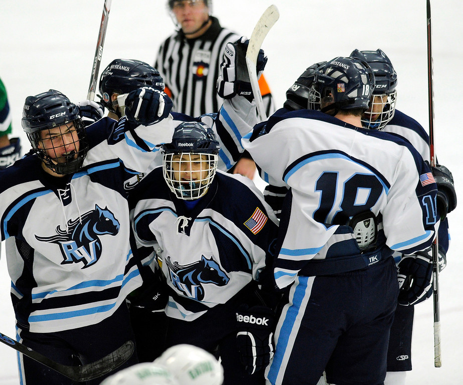 . Mustang players celebrated with junior defenseman Joe Millar who scored the final goal of the game late in the third period. The defending state champion 5A hockey team from Ralston Valley High School skated past Standley Lake 6-1 Tuesday night, December 17, 2013. Photo By Karl Gehring/The Denver Post