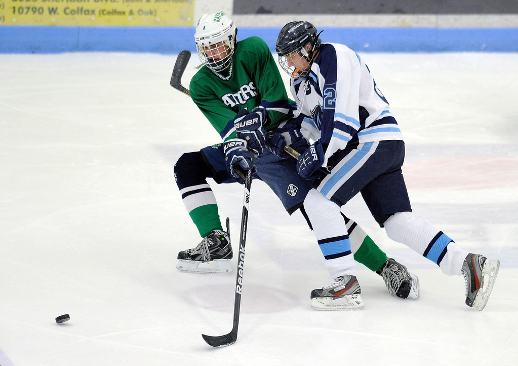 . Gators\' forward Jake Wellborn (4) raced Ralston Valley junior Stone Hubbard (2) to the puck in the second period. The defending state champion hockey team from Ralston Valley High School took on Standley Lake Tuesday night, December 17, 2013. Photo By Karl Gehring/The Denver Post