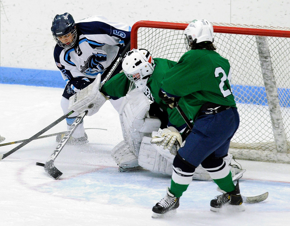 . Ralston Valley senior defenseman Alec Lemmon (5) looked to convert a rebound in front of Gators\' goalie Ryan Young (1) in the second period. The defending state champion hockey team from  Ralston Valley High School took on Standley LakeTuesday night, December 17, 2013. Photo By Karl Gehring/The Denver Post