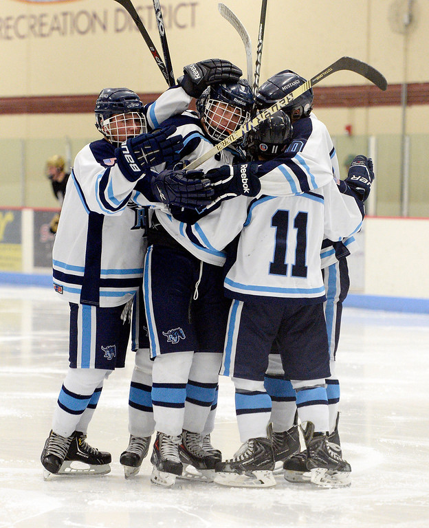 . Ralston Valley teammates celebrate a goal by Greg Dyba (7), middle, during the second period against Monarch January 14, 2014 at Apex Ice Arena. (Photo by John Leyba/The Denver Post)