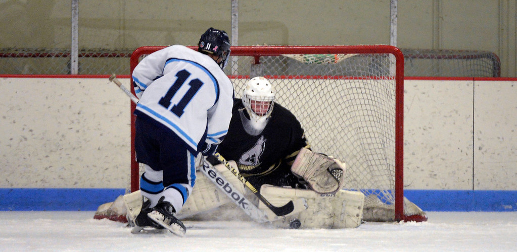 . Monarch goalie Baily Aust (31) makes a save on a penalty shot by Ralston Valley Austin Resseguie (11) during the first period January 14, 2014 at Apex Ice Arena. (Photo by John Leyba/The Denver Post)