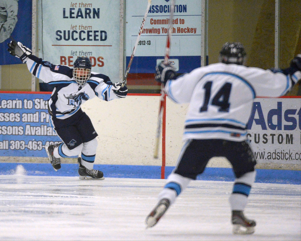. Ralston Valley Cody Noel (6) celebrates his gaol during the third period against Monarch January 14, 2014 at Apex Ice Arena. (Photo by John Leyba/The Denver Post)