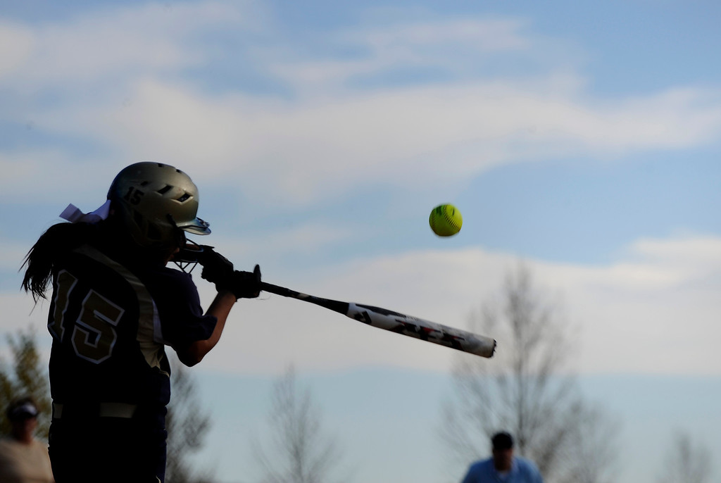 . AURORA CO: Oct. 19, 2013  Legacy High School player Shania Leon hits the ball during her team\'s game in the 5A softball quarterfinals at the Aurora Sports Park on Oct. 19, 2013.   (Photo By Erin Hull/The Denver Post)