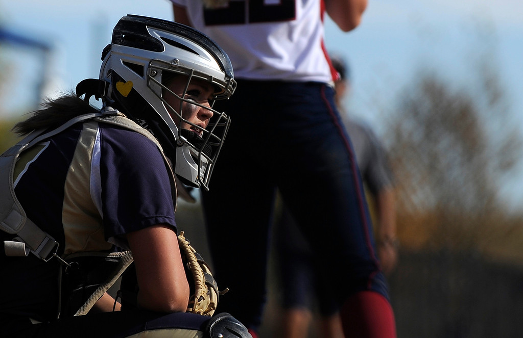 . AURORA CO: Oct. 19, 2013  Celyn Whitt, of Legacy High School, watches her coach before signaling to the team\'s pitcher. The 5A softball quarterfinals were held at the Aurora Sports Park on Oct. 19, 2013.   (Photo By Erin Hull/The Denver Post)
