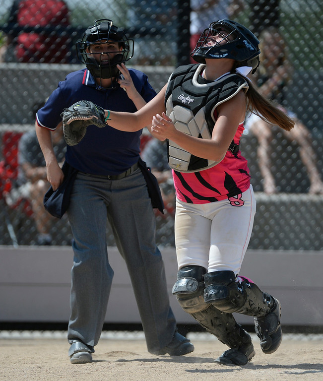 . Colorado Styxx catcher, Kara Jones, Rampart High School, looks for a pop foul  during a game against the Louisville Lady Sluggers at the Colorado Sparkler, Junior Sparkler and Fireworks girls fast pitch club softball tournament at the Aurora Sports Park Wednesday afternoon, July 02, 2014, (Photo By Andy Cross / The Denver Post)