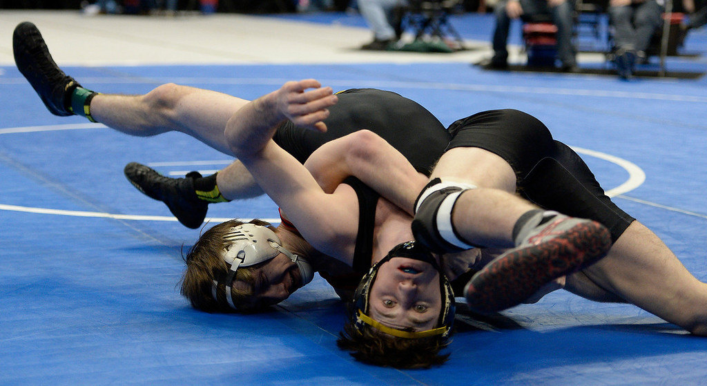 . Matt Sandoval of Montrose flips over Ben Hewson of Thompson Valley during their class 4A 138 pound match on the first day of Colorado High School State Wrestling February 20, 2014 Pepsi Center. (Photo by John Leyba/The Denver Post)