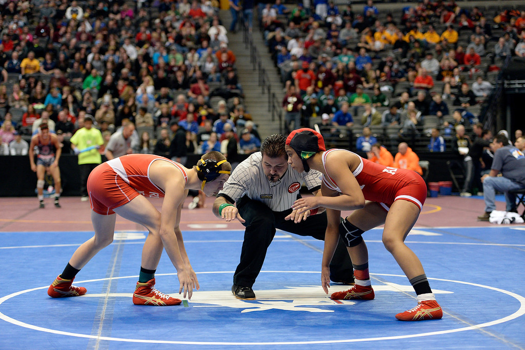 . Carl Camposamnto of Regis takes on Maya Nelson of Denver East during their  5A 106-pound match on the first day of Colorado High School State Wrestling February 20, 2014 Pepsi Center. Finesilver defeated Berry (Photo by John Leyba/The Denver Post)