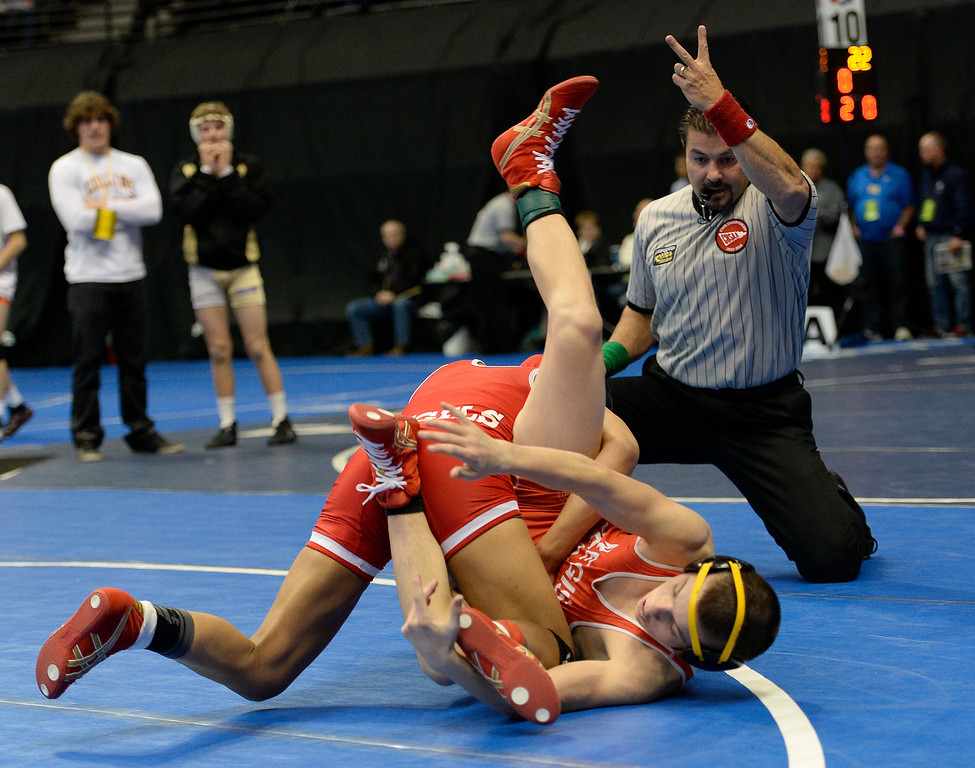 . Maya Nelson of Denver East earns two points against Carl Camposanto of Regis during their 5A 106-pound match on the first day of Colorado High School State Wrestling February 20, 2014 Pepsi Center. Maya defeated Camposanto 13-9.  (Photo by John Leyba/The Denver Post)