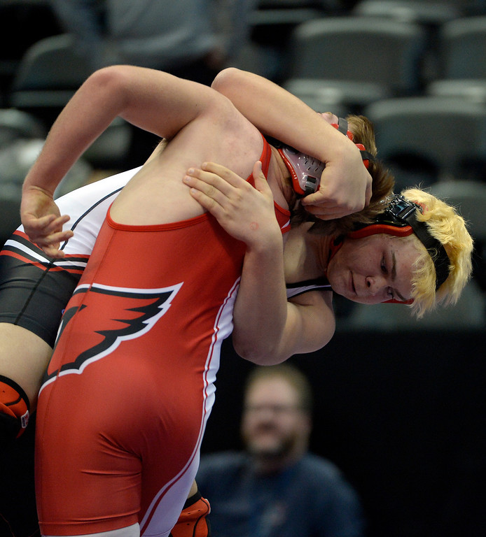 . Jon Satterly of Burlington, top, pulls down Sam Cox of McClave during Class 2A 220 pound action on the first day of Colorado High School State Wrestling February 20, 2014 Pepsi Center. Satterly defeated Cox by pin.  (Photo by John Leyba/The Denver Post)