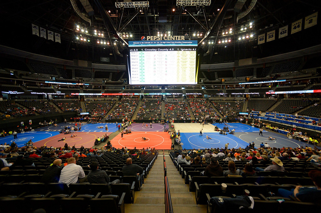 . A small crowd gathers to watch the 2A/3A on the first day of Colorado High School State Wrestling February 20, 2014 Pepsi Center. (Photo by John Leyba/The Denver Post)