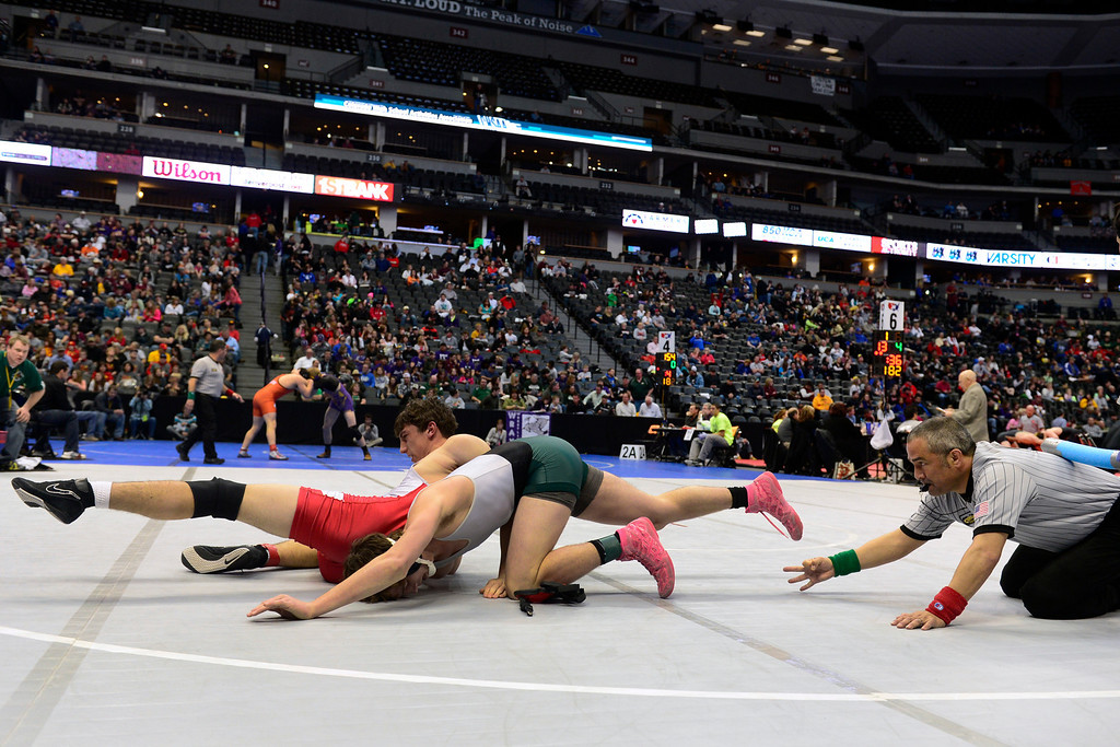 . DENVER, CO - FEBRUARY 21: Christian Knoll from Ignacio, left, wrested M.C. Griffin from Stratton in the 2A 182 pound class. The Colorado Wresting State Championships take place at the Pepsi Center with the quarterfinals taking place on Friday, Feb. 21, 2014. (Photo by Kathryn Scott Osler/The Denver Post)