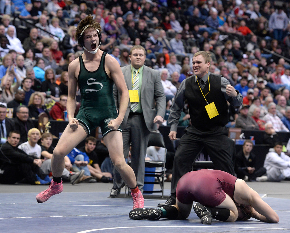 . DENVER, CO - FEBRUARY 22: M.C. Griffin of Stratton (in green) celebrates after defeating Brody Wisemon of Swink in the 2A 182lb. championship match. The Colorado Wrestling Tournament was held at the Pepsi Center in Denver, Colo. on February 22, 2014. (Photo by Andy Cross/The Denver Post)